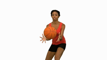 Pretty woman catching and throwing a basketball on white screen