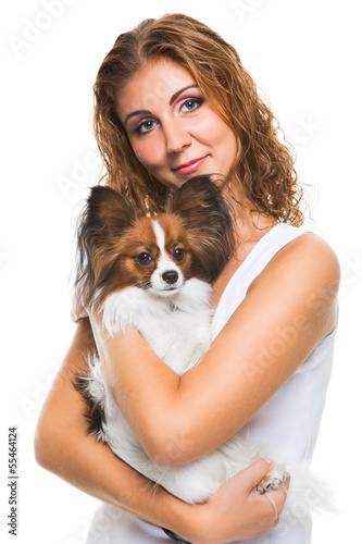 beautiful girl with cute papillon dog on isolated white