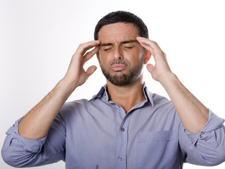 Young Man with Beard suffering Headache