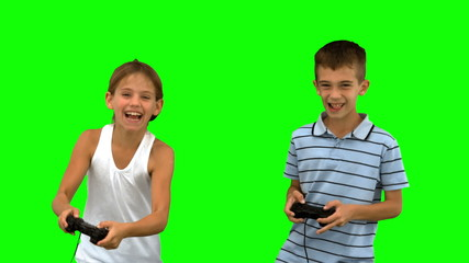 Siblings playing video games on green screen