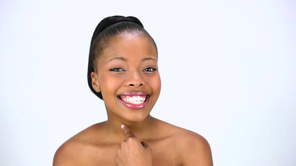 Cheerful model applying cream