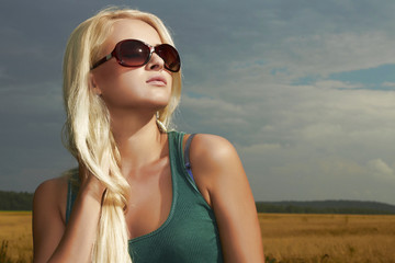 Beautiful blond girl.nature background.beauty woman.sunglasses