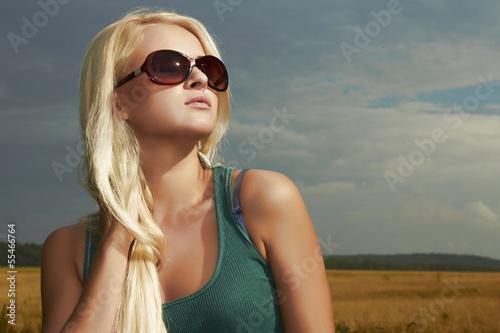 Beautiful blond girl.nature background.beauty woman.sunglasses