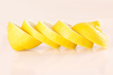 Row of juicy yellow lemon sliced wheels
