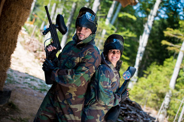 Paintball players posing to the camera
