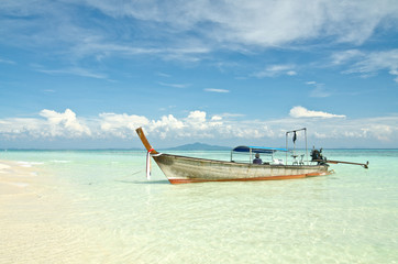 Beautiful image Longtail boat on the sea tropical beach. Andaman