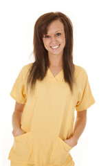 nurse yellow scrubs stand