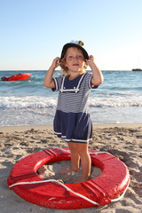 young happy child girl ready for travel by boat