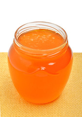 Glass jar with golden fresh honey