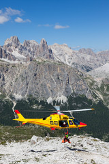 Mountain rescue with a Helicopter in the Alps.