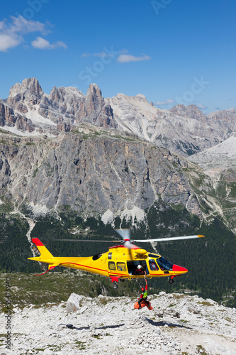 Tuinposter Helicopter Mountain rescue with a Helicopter in the Alps.