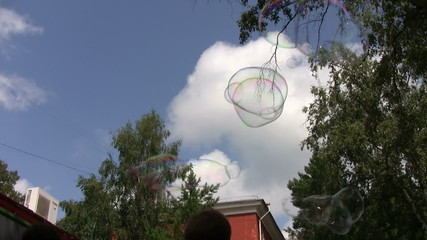 Kids making giant soap bubbles outdoors