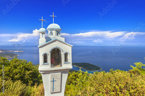 Small church icon in Greece Ithaki island with sea background an