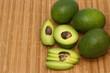 fresh avocado fruits on wooden background