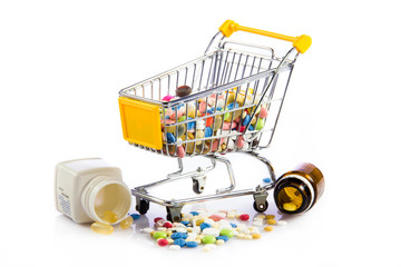 colorful tablets in the cart.  Shopping cart with medicine pills
