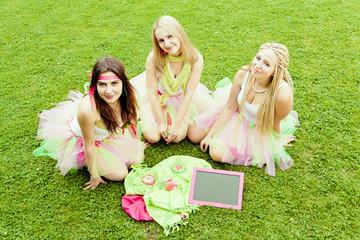group of beautiful female friends smiling.  three pretty  girls
