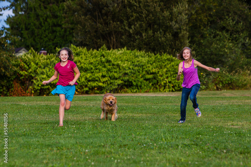 kids racing a dog