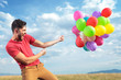 casual man with colorful balloons