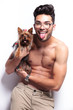 topless young man panting with puppy