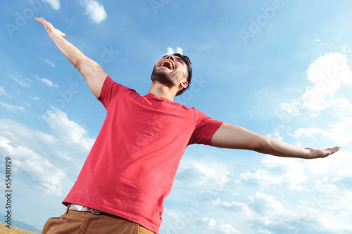casual man screaming at the sky