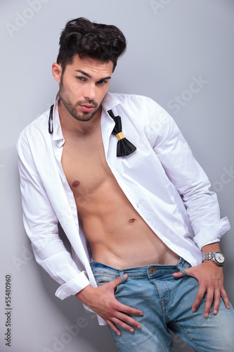 attractive young man with thumbs in jeans loops