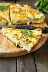 Frittata slices on a cutting board and knife