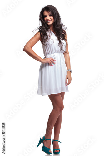 beautiful woman smiling with hand on hip