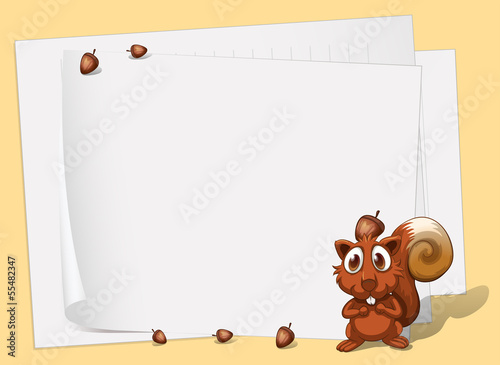 A squirrel in front of the empty papers