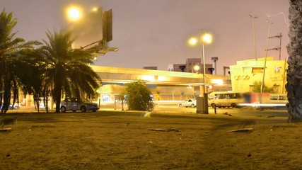 traffic signal in Jeddah with lightnings at night time lapse