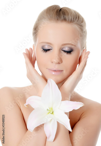 The beautiful blonde woman with lily flower