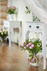 White vase full of pink roses