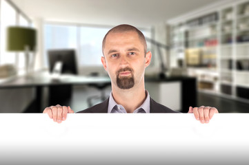 Businessman showing blank empty white billboard sign