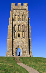 St Michael's Tower with lady silhouette at Glastonbury Tor