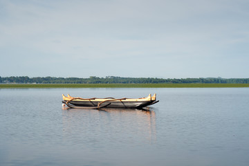 small wooden catamaran in the Soustons lake