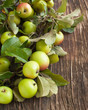 Organic Apples with leaves on wooden background