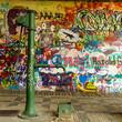 Leinwandbild Motiv Water Well and a Graffiti Wall
