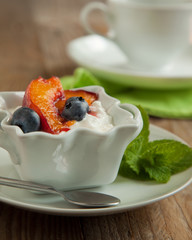 Cottage cheese with blueberries and caramelized peaches