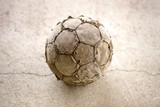 Old used football on asphalt