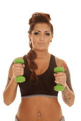 Woman tattoos fitness green weights by chest