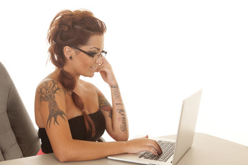 Woman tattoos computer side serious type