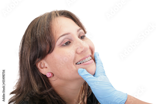 Woman checking his routine brackets on her dentist