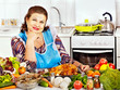 Mature woman preparing at kitchen.