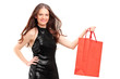 Attractive young woman holding a shopping bag