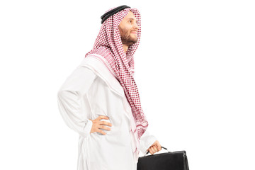 Male arab person with suitcase posing