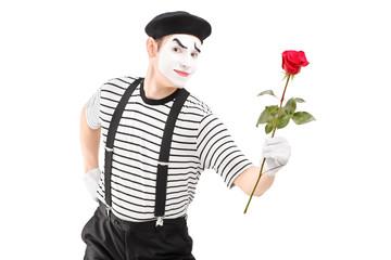 Mime artist giving a rose flower