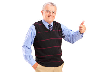 Smiling mature man giving a thumb up