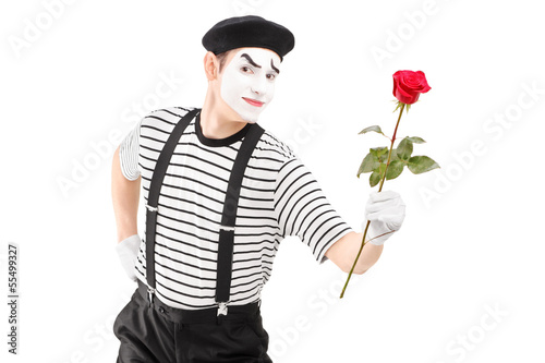 Mime artist giving a rose flower