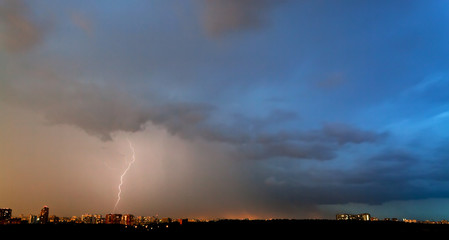 storm and thunderbolt over city