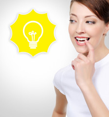 Smiling white woman with electric lamp