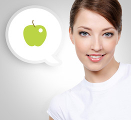 Smiling white woman with green apple